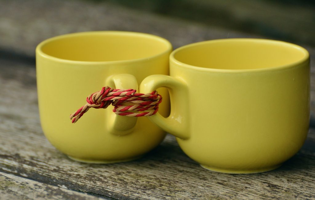 Two mugs tied together to help keep connected on social media